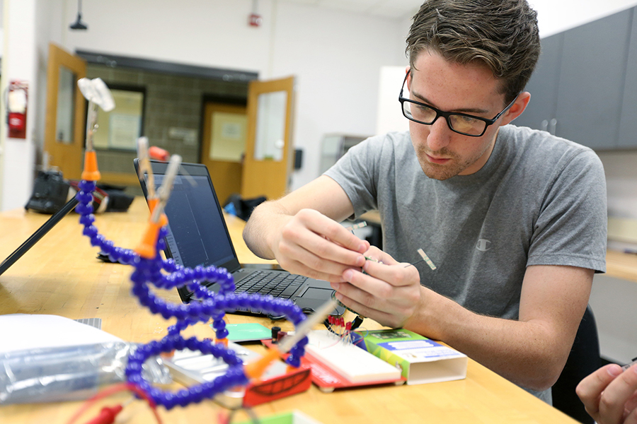 A computer engineering student works in a Fryklund Hall lab at UW-Stout.