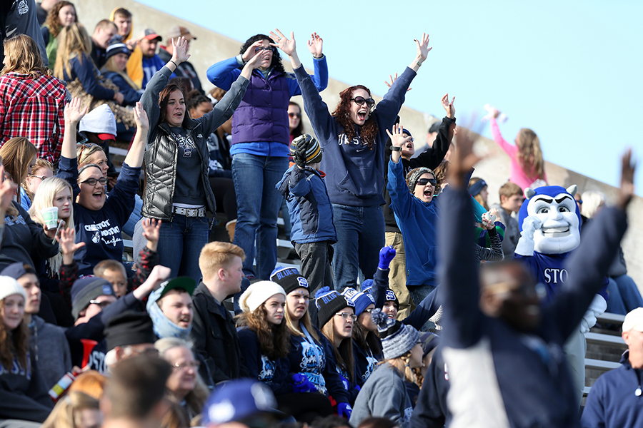 UW-Stout fans, including the mascot Blaze, cheer on the Blue Devil football team.