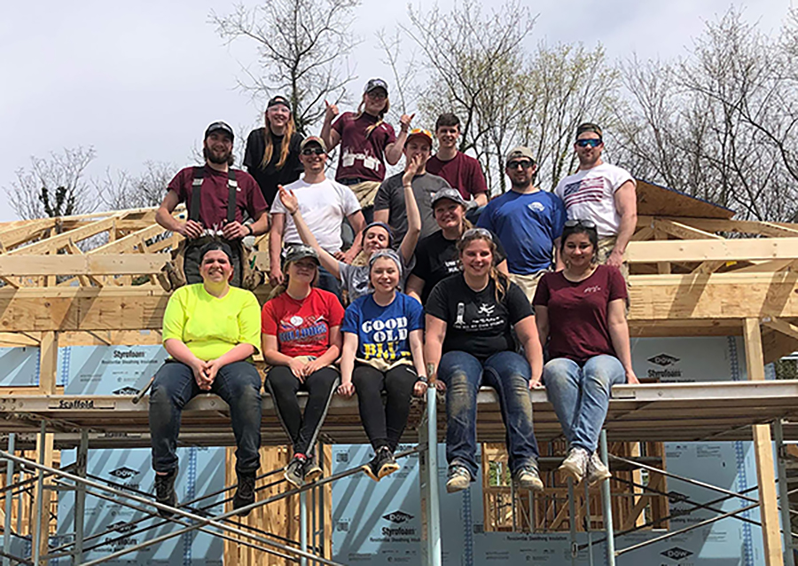 Nilu Umarova, front row right, helps build a home in North Carolina in 2019 with UW-Stout's student chapter of Habitat for Humanity.