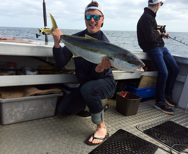 Klobucar shows off a kingfish he caught while in New Zealand.
