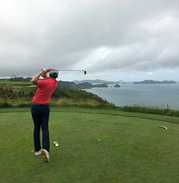 Klobucar tees off on the seventh hole at Kauri Cliffs, a resort golf course in New Zealand where he had a co-op
