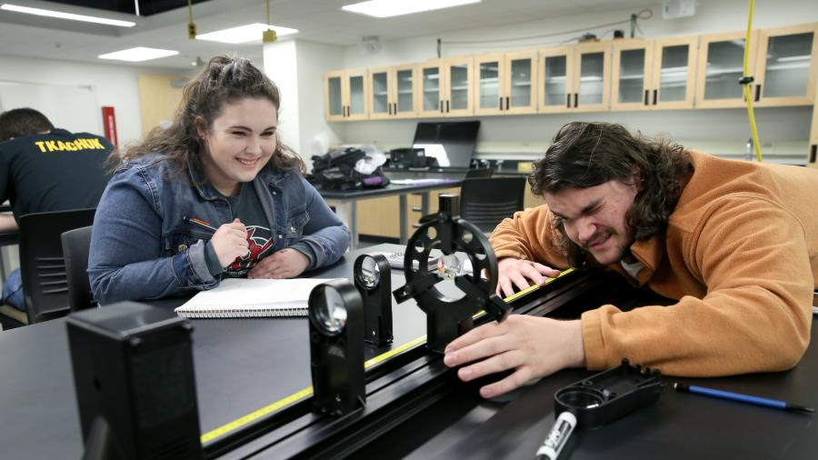 Students in Associate Professor Todd Zimmerman's Applied Optics and Photonics class (PHY 335) are photographed during a lab activity in room 101 Jarvis Hall