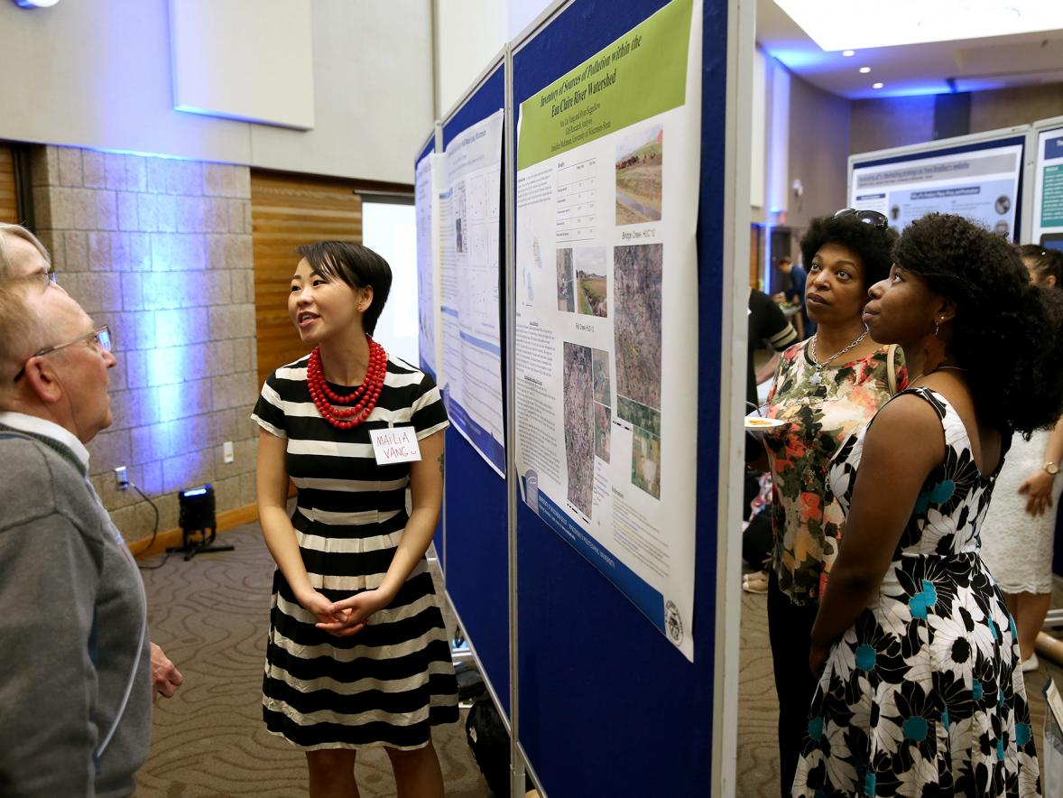 "UW-Stout McNair Scholar Mai Lia Vang describes her research on ""Urban Phosphorus Runoff and Loading to Half Moon Lake, Wisconsin"" at the Memorial Student Center."