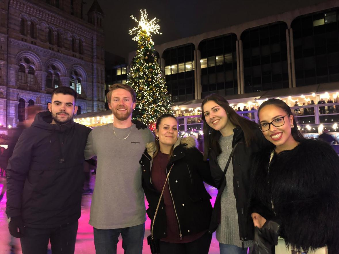 Maxwell Corner enjoys a holiday celebration in Europe with other international students.