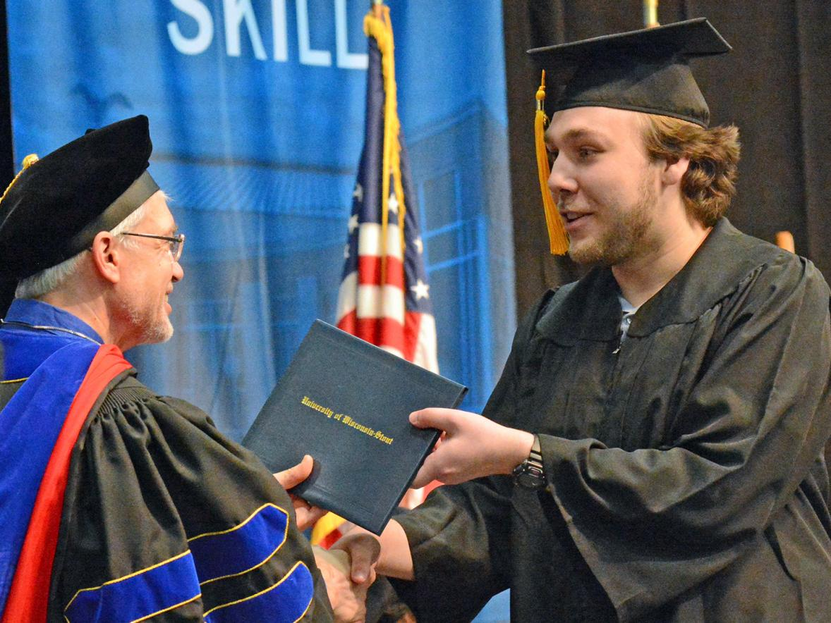 Taylor Thomas receives his diploma Dec. 14.