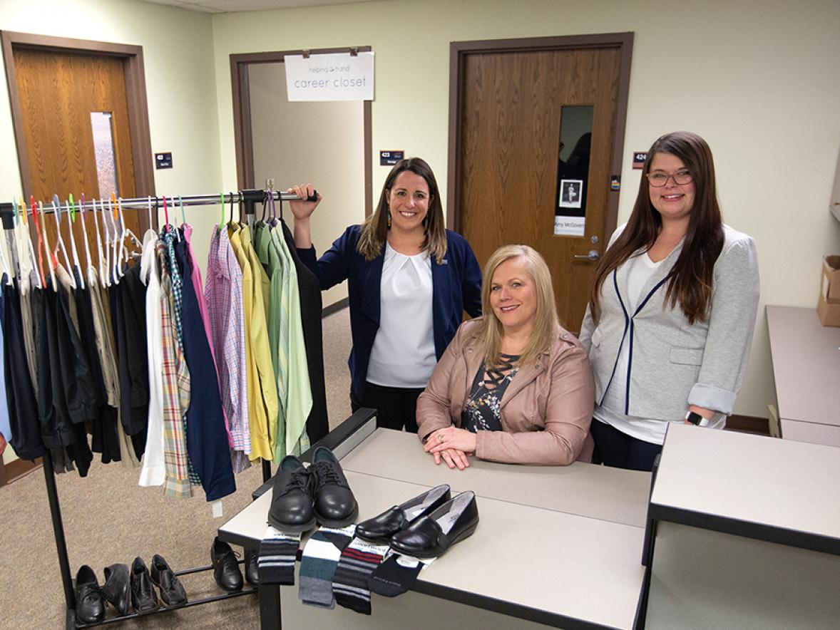 Katie Hauge, at left, Career Services employee relations manager, with Jennifer Krueger, and Chantel Formeister, of Mason Companies, show items donated by Mason Companies to the university career closet.