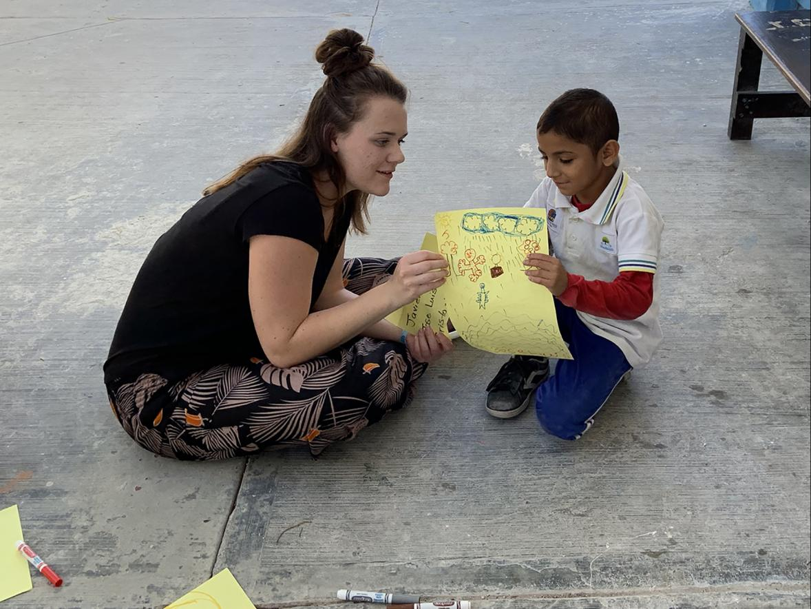 Lindsey Fick, an early childhood education major, works with a child at a school in Cozumel, Mexico, during a recent UW-Stout Winterm course in January.