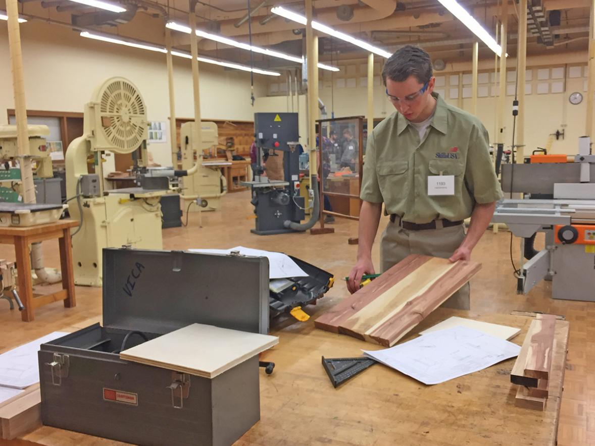 Spencer Tennies, a senior at Slinger High School, participates in the cabinetry making competition at UW-Stout's Regional SkillsUSA.