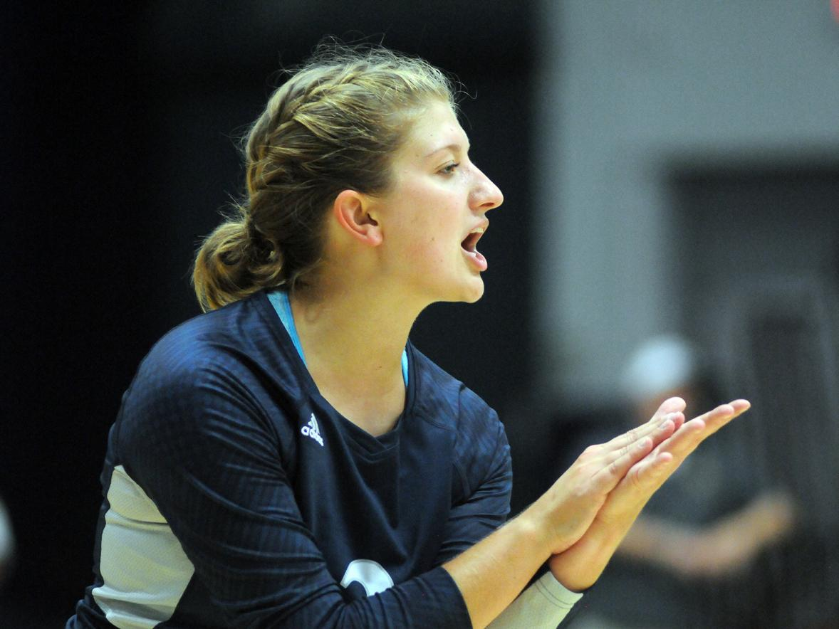 Jessica DuVal celebrates on the volleyball court.