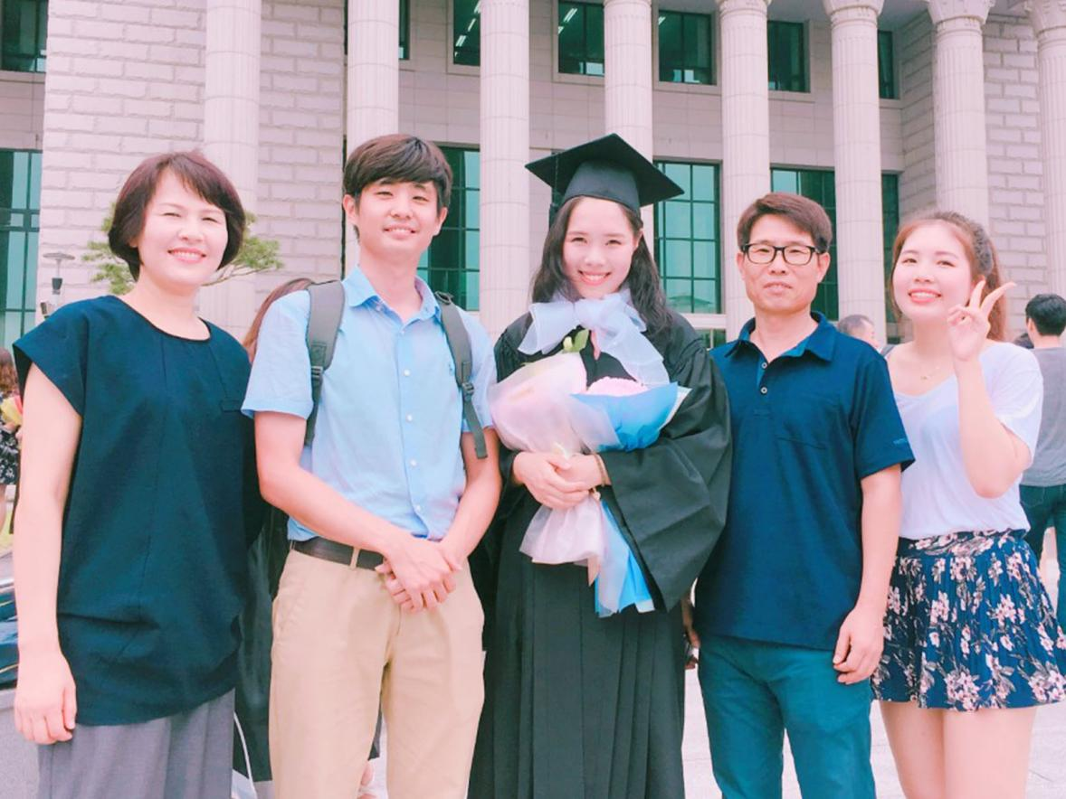 Jeongwon Kim, center, with her family at her graduation from Hankuk University of Foreign Studies.