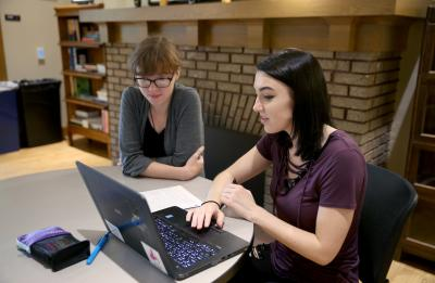 Student working with a tutor in the Writing Center.