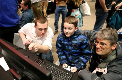 A UW-Stout student, left, explains how his game works at the game expo Wednesday, Dec. 13, in the Memorial Student Center. About 500 people tried games created by game design and development majors.