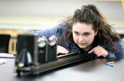 UW-Stout student in the Applied Optics and Photonics class in Jarvis Hall.