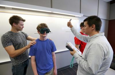Students in psychology professor Desiree Budd's Introduction to Cognitive Neuroscience class do a lab activity utilizing perception goggles Friday, September 15, 2017.